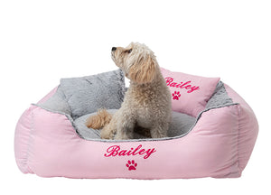 Pink dog bed customised with hot pink embroidery of dog name and paw