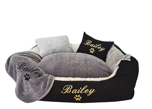 Reversible dog blanket with black embroidery of dog name on grey fluffy material