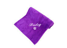 Personalised spa towel for dogs with white embroidery on soft purple fabric