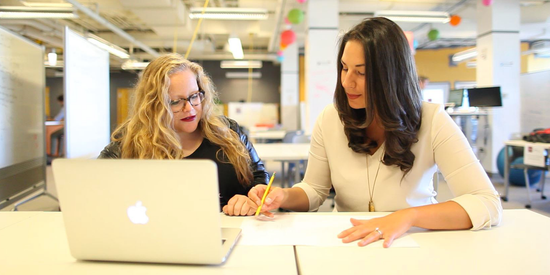 Flare's Co-founders, Quinn and Sara work together at a desk.