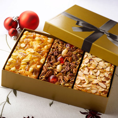 Fruitcake Assortment Of Our Signature Grandma'S Recipe, Pineapple Macadamia With Coconut & Amaretto Fruit And Nut Cake 3-1 Lb Loaves In Elegant Gold Gift Box