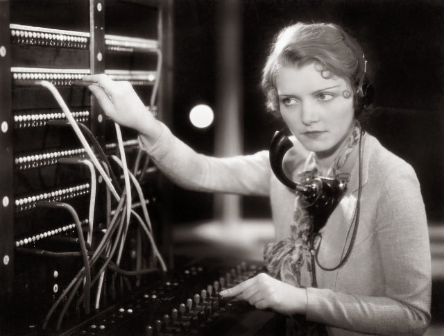 Black and White picture of a Pretty blond Operator on the switchboard