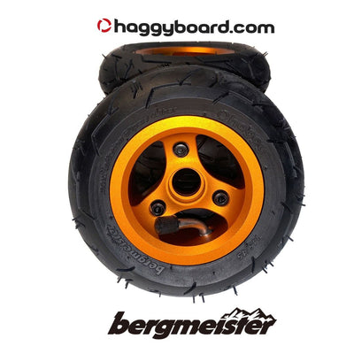 Shiny orange anodized Bergmeister pneumatic all-terrain wheel 147mm diameter 45mm width