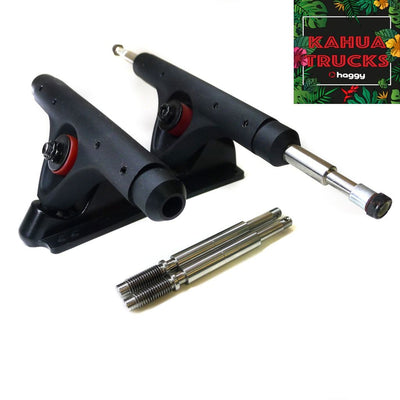 Black Kahua extra wide longboard trucks with partly installed screw-in axles