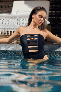 MBM Swim one-piece cut out with high cut sides swimsuit on beautiful model in a pool
