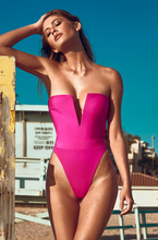 Load image into Gallery viewer, MBM Swim pink Fuchsia one-piece thong swimsuit monokini beach photoshoot at golden hour model Nikki Murciano