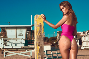 MBM Swim pink Fuchsia one-piece thong swimsuit monokini beach photoshoot at golden hour model Nikki Murciano