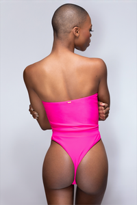 MBM Swim pink Fuchsia one-piece thong swimsuit monokini beautiful black dark skin bald model