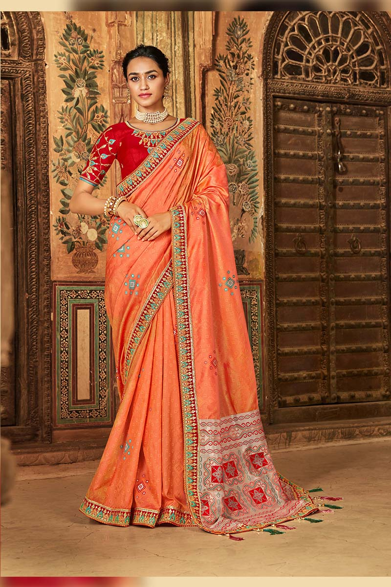 Designer Traditional Heavy Banarasi Silk Jacquard Saree In Orange Colour.
