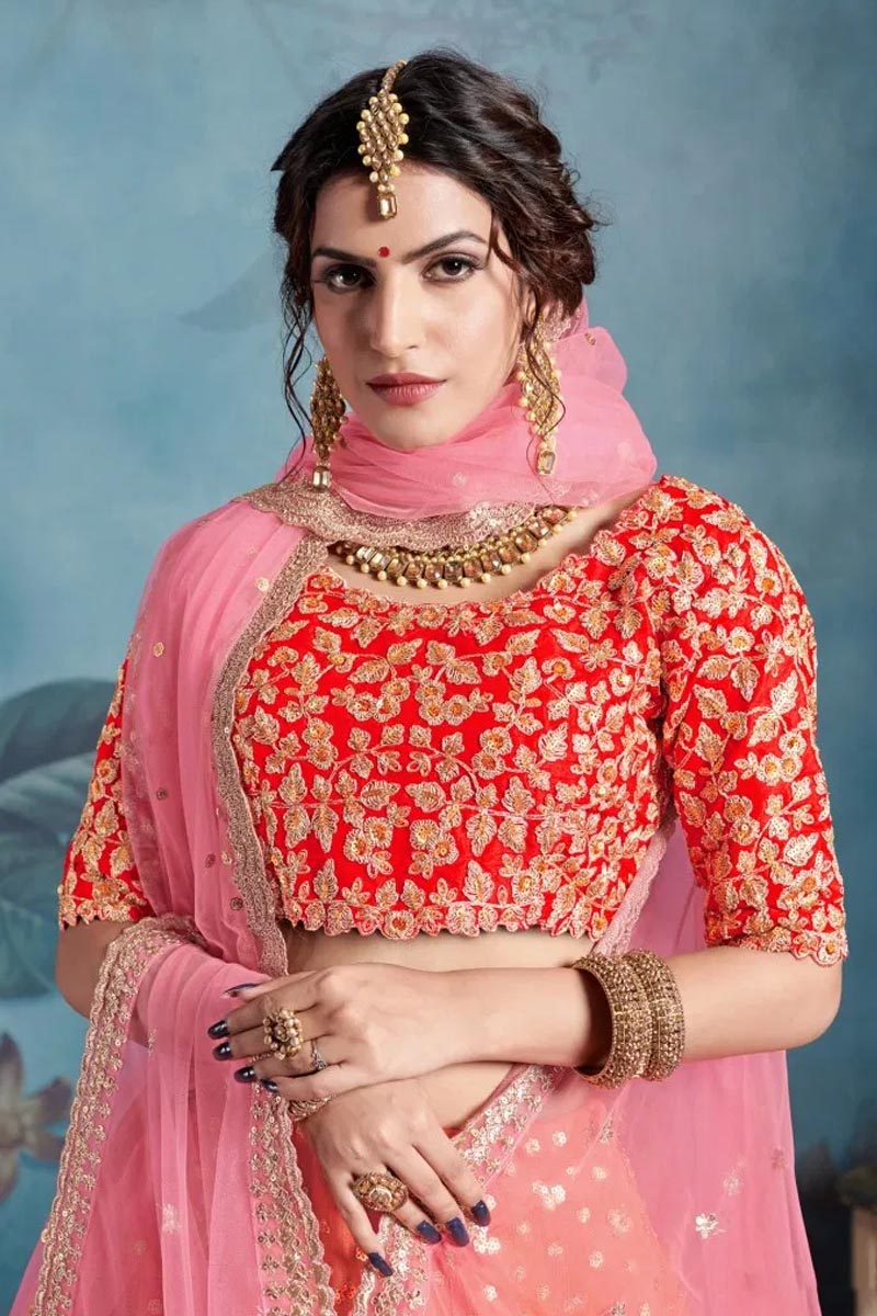 Designer Wear Lehenga Choli in Orange.