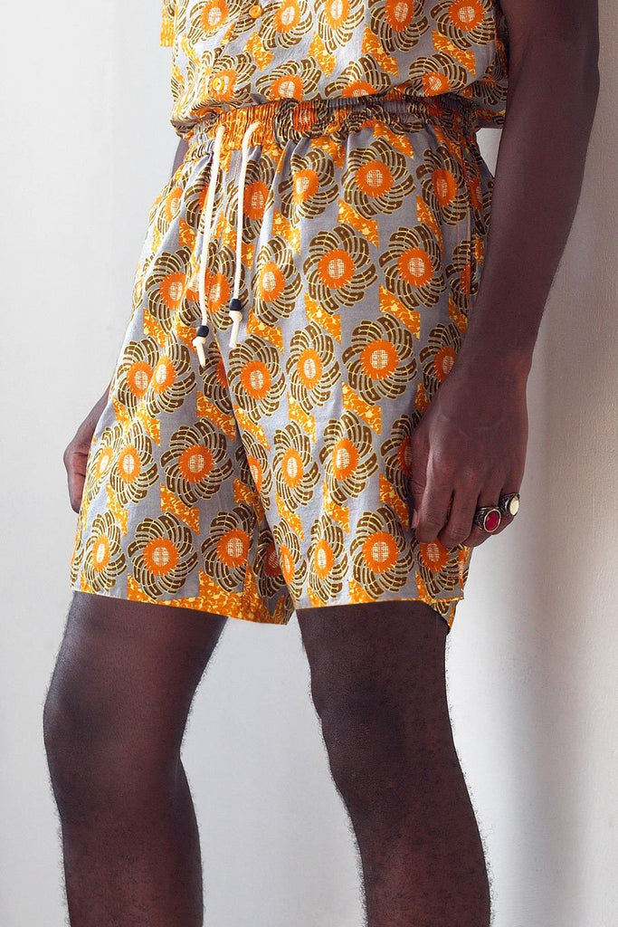 Unisex Sustainable Cotton Shorts in Orange & Gray Print