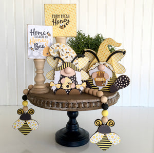 Bumble Bee themed girl and boy gnomes with bee hive and honey pot.  Handmade home decor project for tiered trays, mantel, and shelves.  Bumble bee garland with wood beads.  Farm fresh honey block and Home is where my honey bee block.