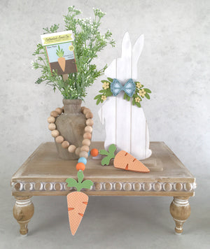 Shiplap Easter bunny decorations.  White easter shiplap bunnies with bows and greenery.  Sitting and Standing Easter bunny decorations.  Wood Easter decorations.  Standing easter bunny on wood tray