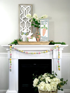 Shiplap Easter bunny decorations.  White easter shiplap bunnies with bows and greenery.  Sitting and Standing Easter bunny decorations.  Wood Easter decorations.  Easter fireplace decorating ideas