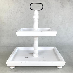 Distressed white rectangle shaped tiered tray.