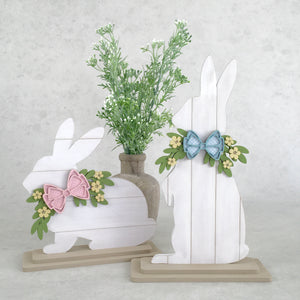 Shiplap Easter bunny decorations.  White easter shiplap bunnies with bows and greenery.  Sitting and Standing Easter bunny decorations.  Wood Easter decorations.