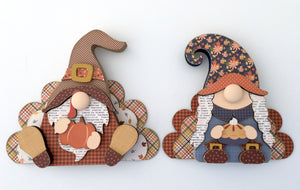 Wood Thanksgiving gnomes that look like a boy and girl pilgrim with turkey wings.  Made for DIY wood home decor craft projects, fall, and thanksgiving decorating.