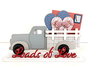 Wood farmhouse truck with interchangeable bed inserts. Pick up truck with hearts and love letter in the bed of the truck. Valentine wood decor crafts. Handmade wood crafts