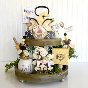 Rae Dunn inspired tiered tray ideas. Bumble Bee themed girl and boy gnomes with bee hive and honey pot.  Handmade home decor project for tiered trays, mantel, and shelves.  Bumble bee garland with wood beads.  Farm fresh honey block and Home is where my honey bee block.