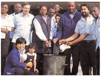 Jerry Yamoa and his colleagues at Nine Elms POst Office in 1998 - throwing away their inhalers after taking Yamoa Powder.