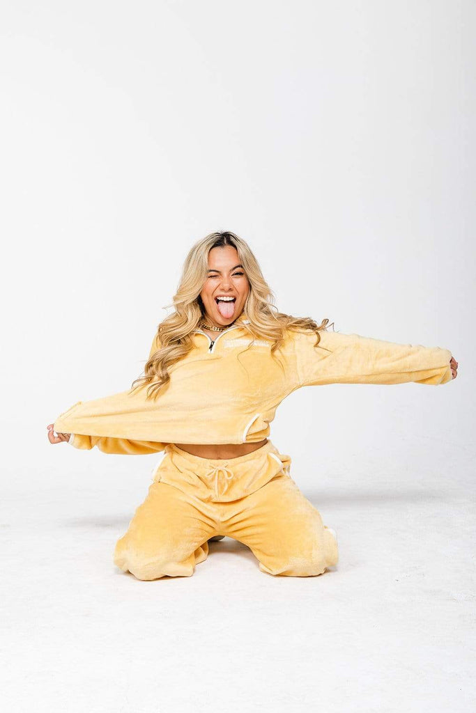 Adelaine Morin: 'Girls Supporting Girls' Yellow Fleece Sweatpants