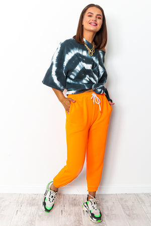 Orange neon drawstring jogging pants