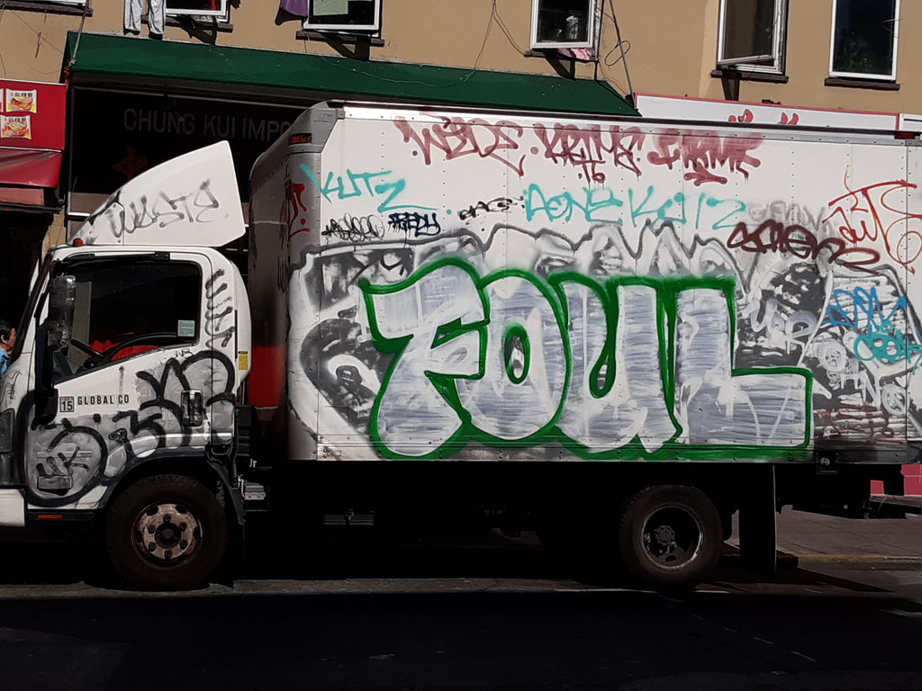 FOUL nyc graffiti on a truck. Lots of tags and tagging on truck. phot by Dave Cramske