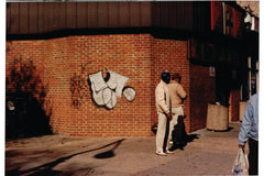 CAST one from Washington D.c. 7eleven king. graffiti throwup. silver black on brick
