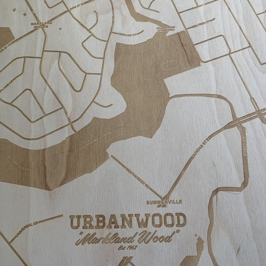image of section of laser etched premium birch plywood map. words standing out are urbanwood, markland wood, est. 1962. a close up of the map and streets.