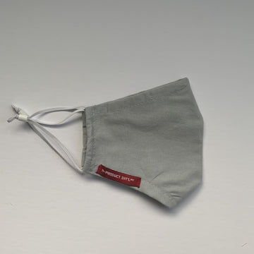image of side of grey mask with red branding tag on white background