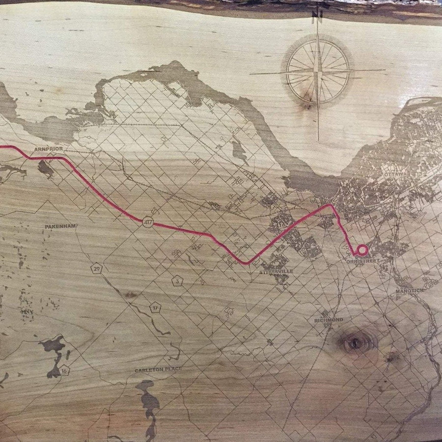 image of laser etched live edge wood map. with route highlighted in red paint.