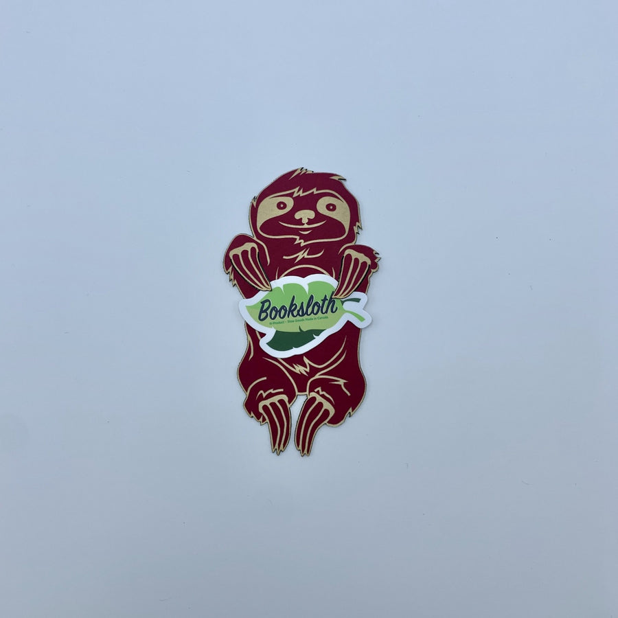 red booksloth holding branded sticker on a white background