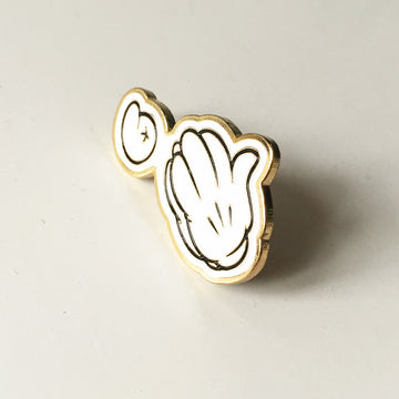white enamel pin image of mickey mouse hands and number six in same style