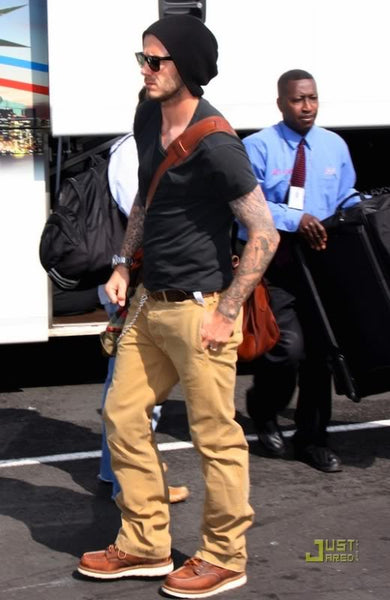 340ec42ed10 David Beckham wearing a slouchy beanie during the work day. Must be tough  looking so good in that hat while traveling. Get a similar style HERE.