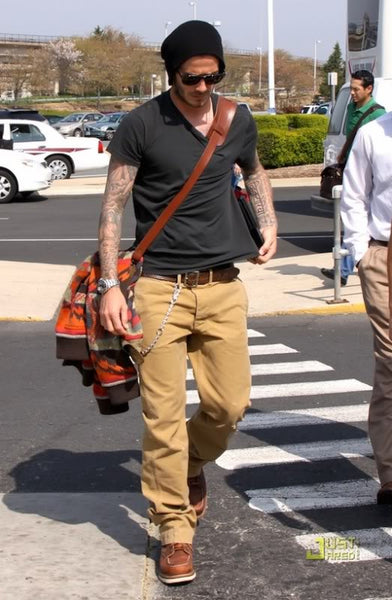 David Beckham wearing a slouchy beanie during the work day. Must be tough  looking so good in that hat while traveling. Get a similar style HERE. 547a20df9f6