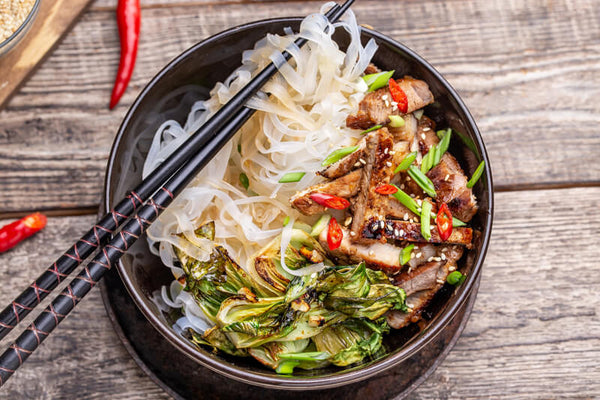 Seared pork with bok choy and rice noodles