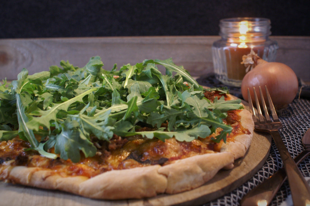 pizza with arugula topping - fresh homemade pizza with sausage, onion, pepper, mushroom