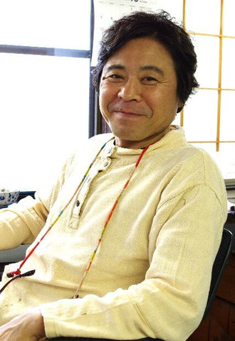 Junichi Hakose at his desk of Hakose Koubou Wajima Japan Photo Copyright by Kogei Styling
