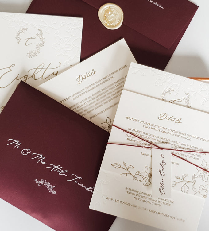 custom made burgundy and gold letterpressed floral wedding invitation with custom wax seal