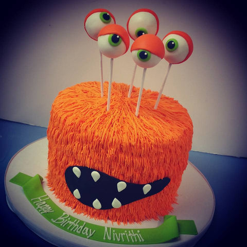 orange monster halloween cake