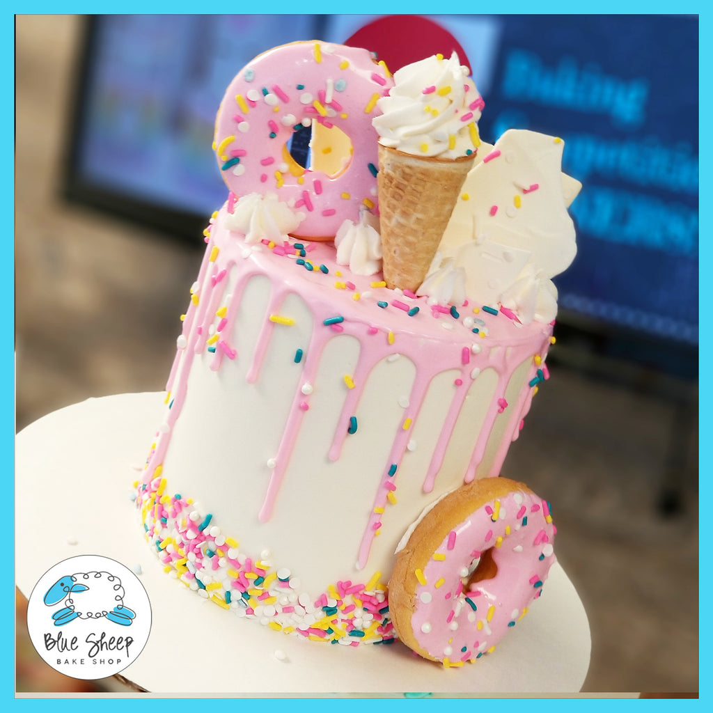 Pink and white ice cream cone confetti donut drip cake nj best cakes