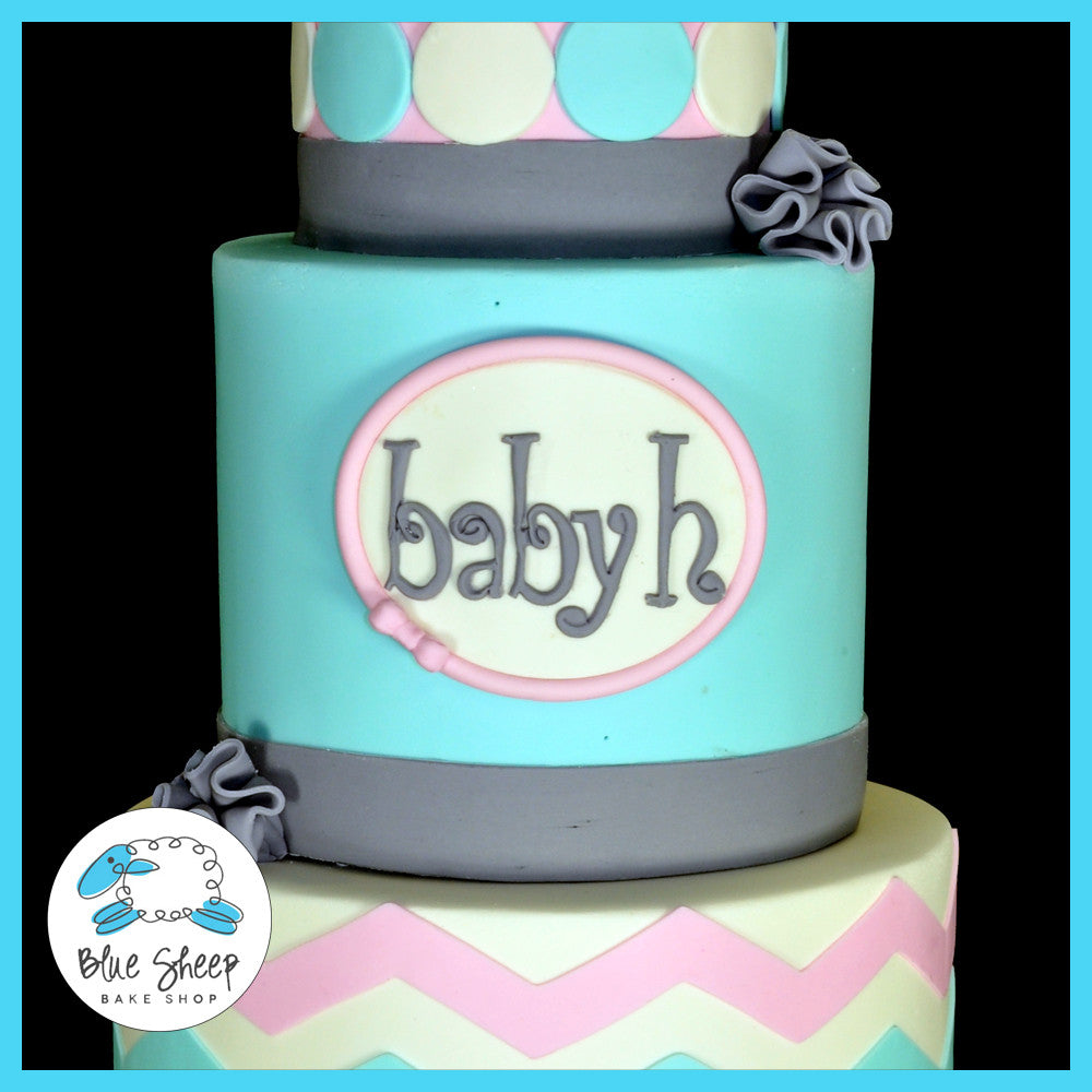 pink blue and grey baby shower cake