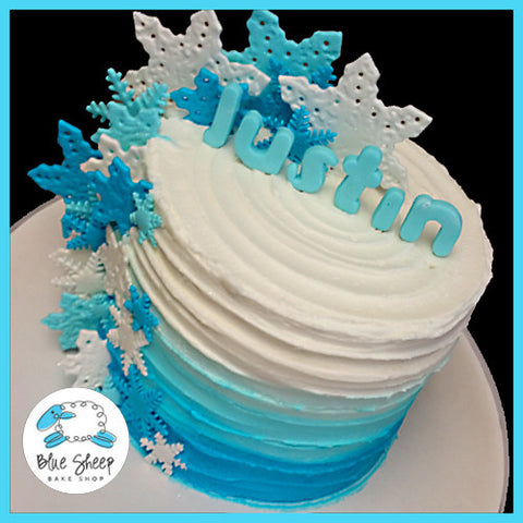 Blue Buttercream Rustic Cake With Snowflakes