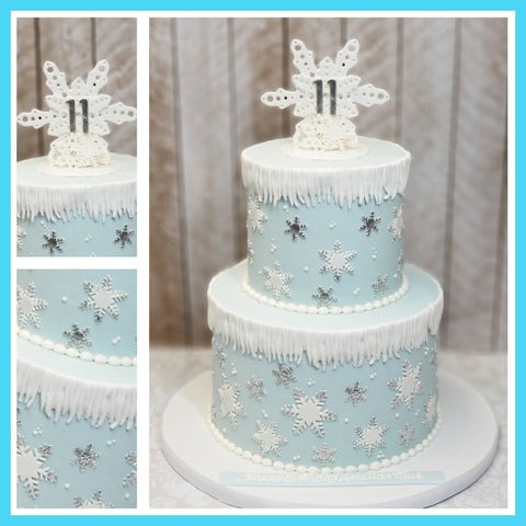 Blue buttercream winter wonderland snowflake cake
