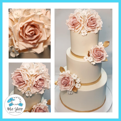 blush and ivory buttercream wedding cake with sugar roses nj