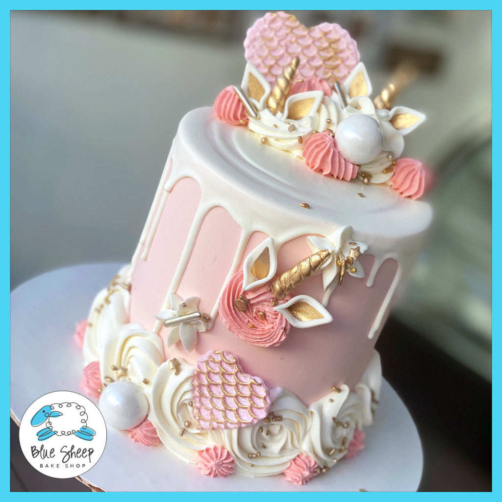 blush unicorn to go cake with chocolate drip nj custom cake