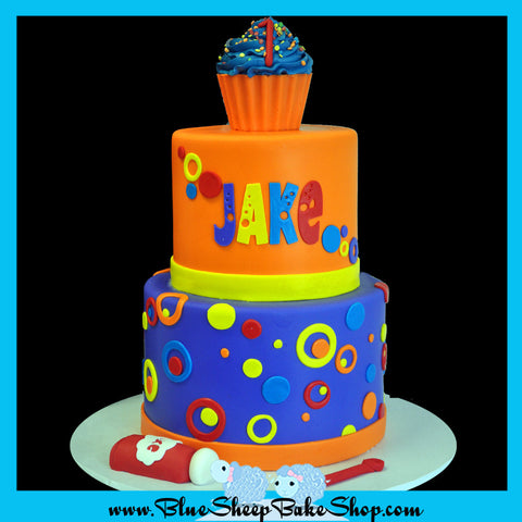 bubble birthday cake first birthday custom cake purple orange yellow red with a cupcake smash cake topper