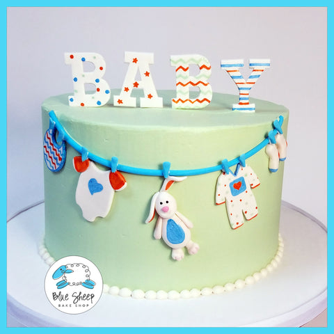 buttercream baby shower cake with clothesline