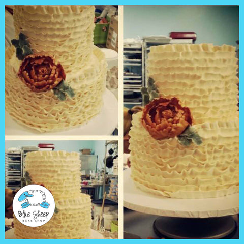 buttercream ruffle wedding cake with peony