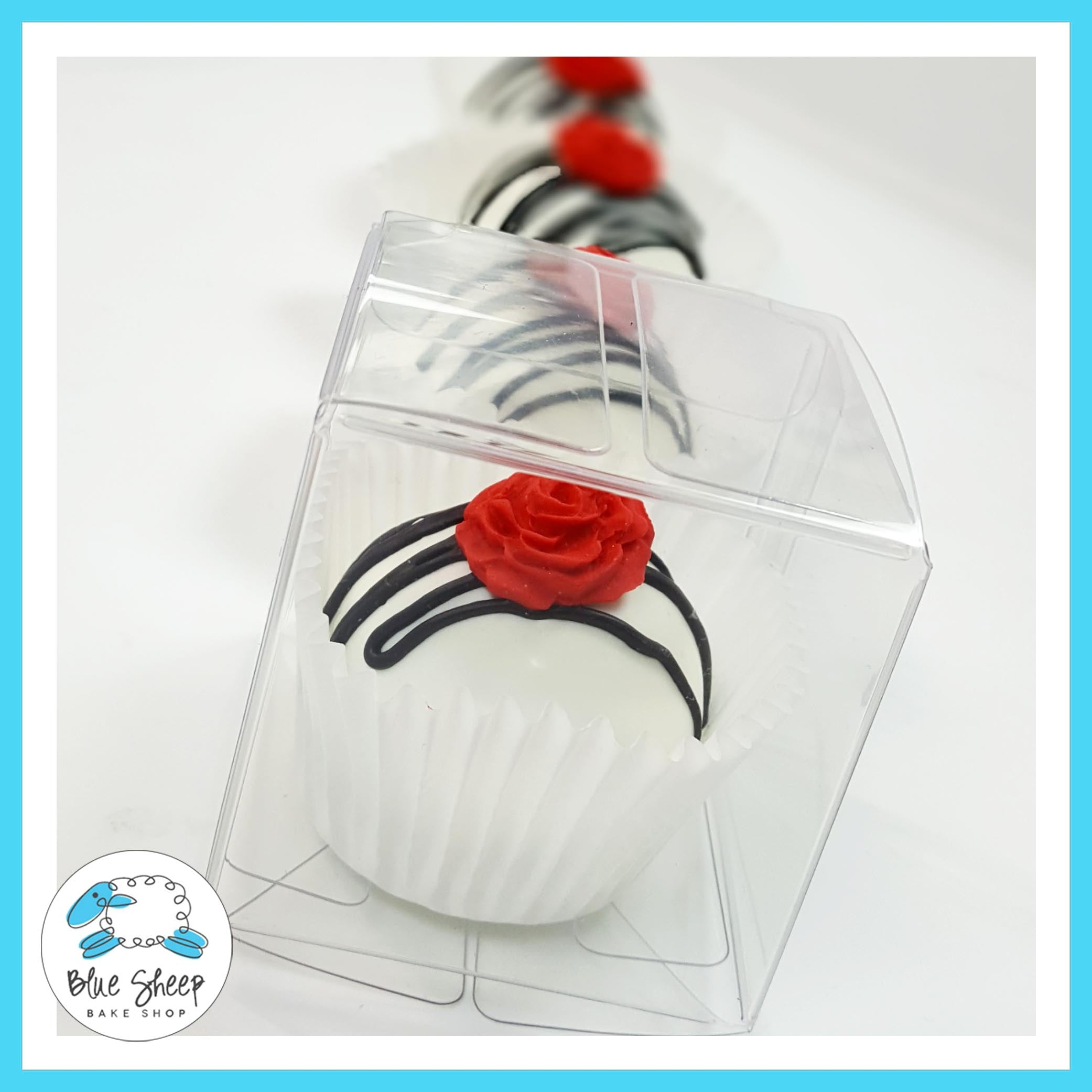 White & BLack Cake Truffle With a Red Rose NJ | Blue Sheep Bake Shop
